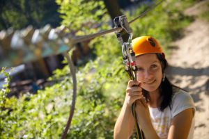 Empower Adventures woman getting ready for zip line