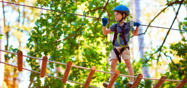 Young boy on a cable engaging in team building activities for kids